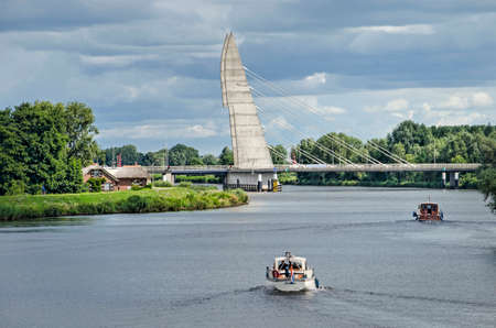 Zwolle, The Netherlands, July 21, 2020: small yachts on Zwartewater river, crossed by Mastenbroeker bridge