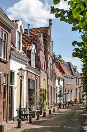 Hasselt, The Netherlands, August 2, 2020: view along a row of historic canal houses on Heerengracht canal in the old town