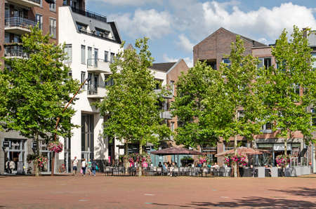 Hardenberg, The Netherlands, July 28, 2020: market square with cafe terraces and modern buildings inspired by traditionale architecture 新闻类图片