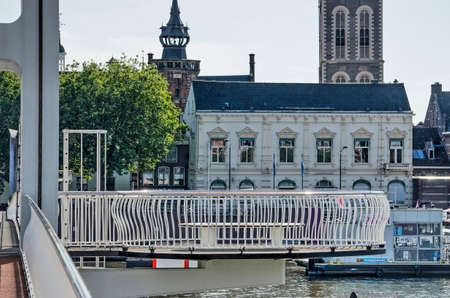 Kampen, The Netherlands, July 30, 2020: observation platform with bench attached to the city bridge across the river IJssel 新闻类图片