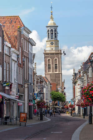 Kampen, The Netherlands, July 26, 2020: view along Oudestraat, the main shopping street with the leaning