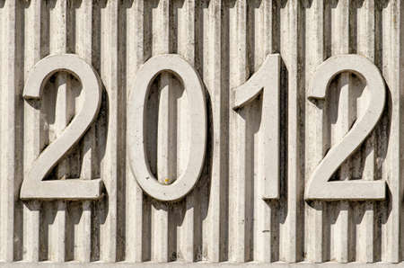 Concrete date-stone with a relief of vertical lines and the year 2012