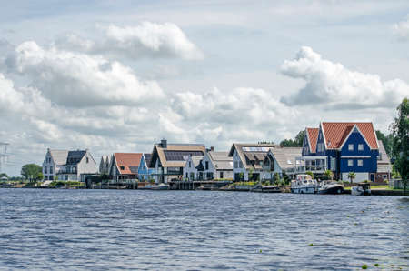 Grafhorst, The Netherlands, August 2, 2020: row of recently constructed luxury houses with traditional elements in various material including wood, plaster and brick