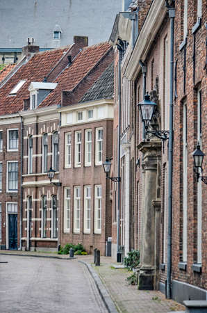 Zwolle, The Netherlands, July 25, 2020: view along a curving street in the old town center with traditional brick houses