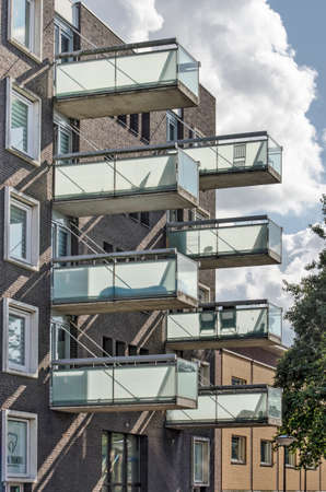 The Hague, The Netherlands, August 23, 2020: facade of a residential building in Wateringseveld neighborhood with canitlever balconies 新闻类图片