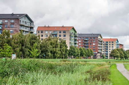 Lansingerland, The Netherlands, August 29, 2020: colorful group of apartment buildings on the edge of Annie MG Schmidt park