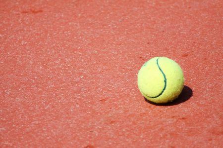 artificial lights: yellow tennis ball on court