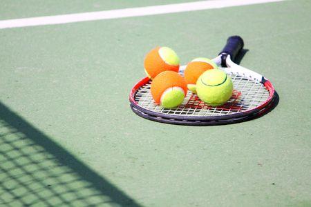 artificial lights: gathering tennis balls Stock Photo
