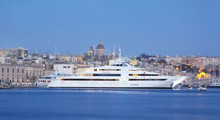 a super yacht berthed in a marina in malta photo