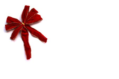 trimmings: a red bow with gold trimmings isolated on a white background Stock Photo
