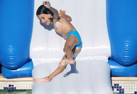 a young girl having fun going down a water slide Stock Photo