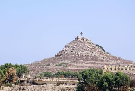 saviour: a statue of christ the saviour known as is-salvatur on a hill top in gozo, part of the maltese islands