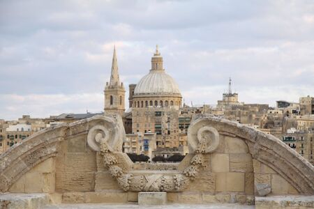 ancient architectural detail with valletta in the background Stock Photo - 5970414