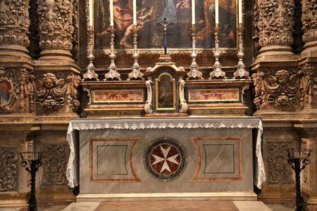 one of the many side altars in st.johns co-cathedral showing the riches and beauty with lots of detail