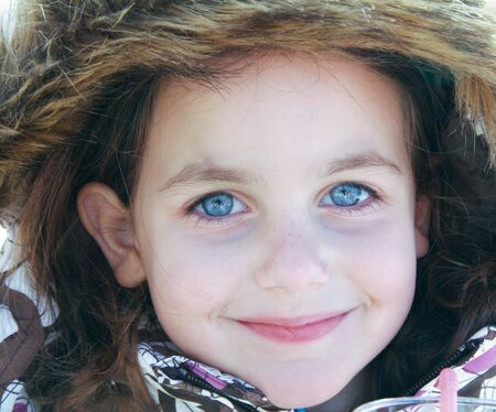portrait of a caucasian pretty girl with blue eyes dressed up for cold weather photo