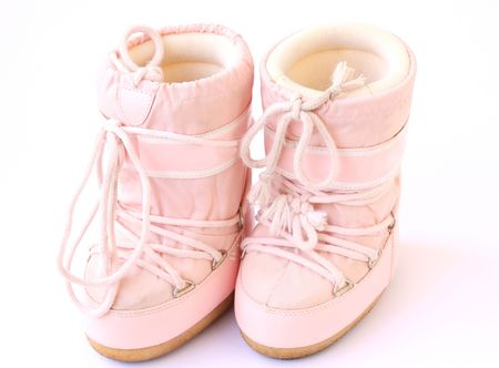 kid's pair of snow boots also known as moon boots isolated on a white background Stock Photo
