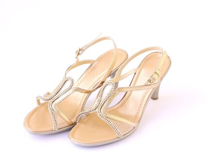 gold female buckle up sandles isolated on a white background Stock Photo - 6247816