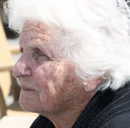 more mature: close-up portrait of a sad old woman  Stock Photo