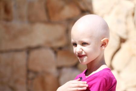 bambino con perdita di capelli cancro di combattimento Archivio Fotografico