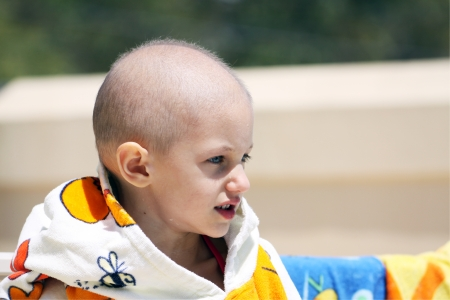 child s first swim after beating cancer photo
