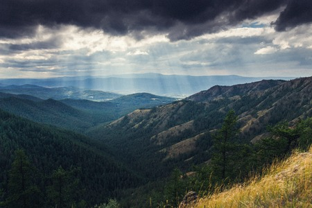 to break through: Landscape of sun rays break through the clouds
