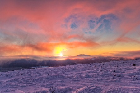 snowfield: Landscape with purple colors, mountains, mist and snowfield. South Ural