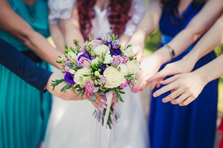 bridesmaids: Bridesmaids are drawn to the Bridal bouquet Stock Photo