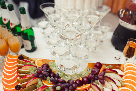 caterers: Decorated table for a festive Banquet, with drinks and fruits Stock Photo
