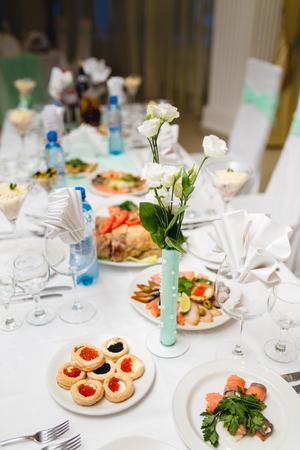 caterers: Decorated table for a festive Banquet, with drinks and snacks Stock Photo