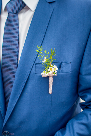 formal dressing: On the grooms jacket attached flower