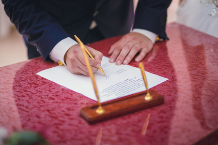 wedlock: Groom signing marriage license or wedding contract