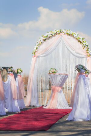 registrar: Arch and decoration for the wedding ceremony outdoors