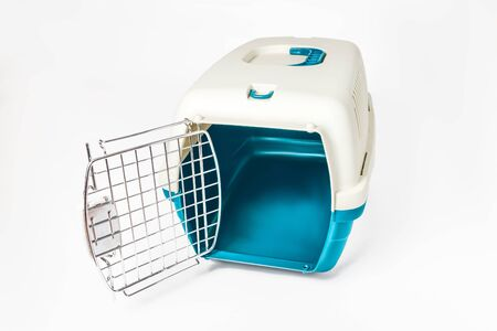 Plastic cage carrying for dogs and cats isolated on white. Travel transportation, veterinary clinic and pet care concept Banco de Imagens
