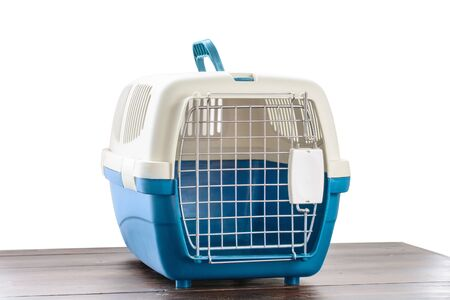 Plastic cage carrying for dogs and cats isolated on white. Travel transportation, veterinary clinic and pet care concept Reklamní fotografie