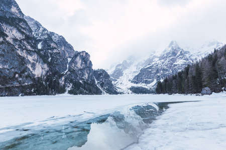 Di Braies lake during the winter in the middle of Alps mountains