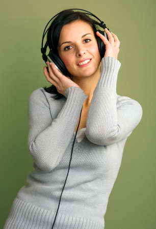 Beautiful happy women listening music in headphones Stock Photo - 2586250
