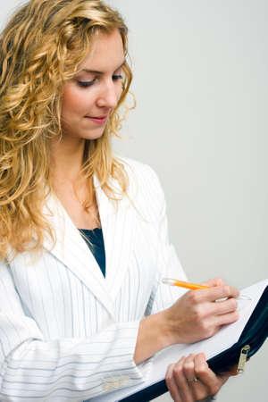 almanac: Attractive young secretary making notes  Stock Photo