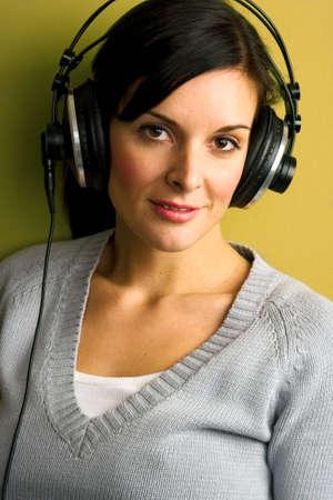 househould: Beautiful happy women listening music in headphones