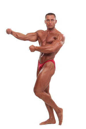 muscular body: Attractive male body builder, demonstrating contest pose, isolated on white background