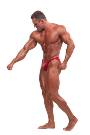 athletic body: Attractive male body builder, demonstrating contest pose, isolated on white background