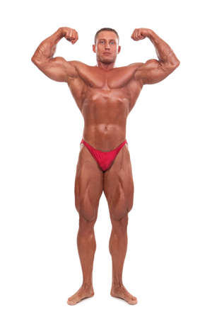 bodybuilder training: Attractive male body builder, demonstrating contest pose, isolated on white background