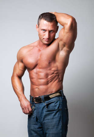 Handsome shirtless man on gray background Stock Photo - 5341279