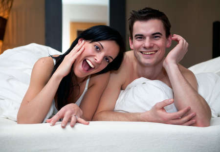 Young couple having fun in the bedroom Stock Photo