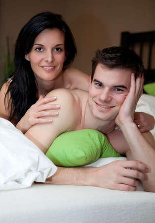 Young couple having fun in the bedroom photo