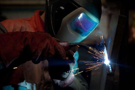 Factory welder doing his job