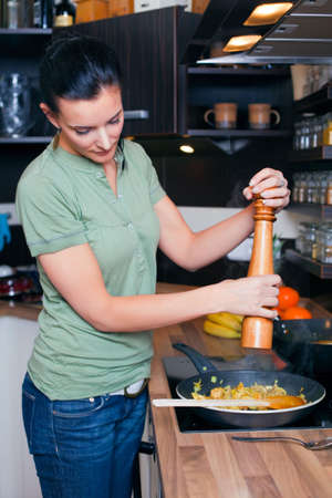 Young woman preparing lunch in kitchen  photo