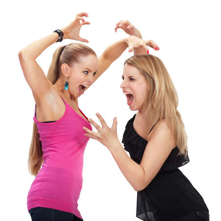 fighting styles: Two young woman in conflict - isolated