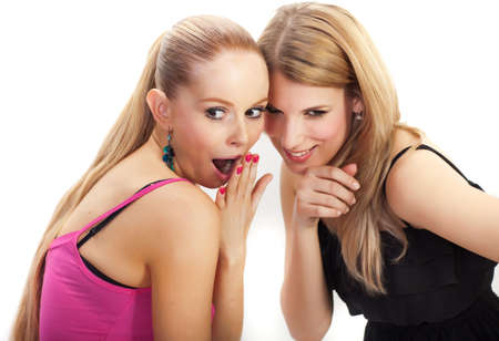 scandal: Two young woman wispering secrets - isolated Stock Photo