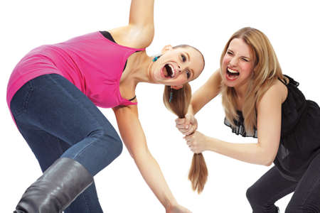 fighting styles: Two young woman in conflict  Stock Photo