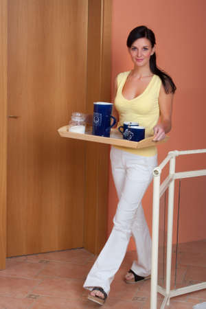 Young brunette woman offer cup of tee